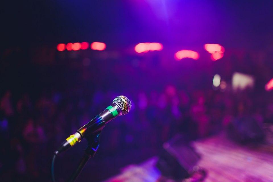 Microphone stand in darkened nightclub